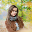 Long-haired girl  in autumn - Stock Photo