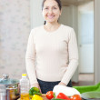 Happy woman with vegetables  — Photo