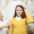 Woman helps the bride in choosing bridal accessories - Stock Photo