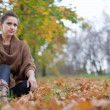 Beauty woman in september park - Stock Photo