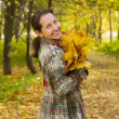 Woman against autumn landscape — Stock Photo