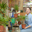 Stock Photo: Womin flower store