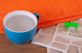 Mustard leaf with towel and cup — Stock Photo