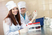 Positive nurse and doctor in clinic lab — Foto Stock