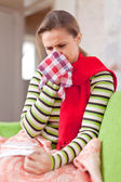 Illness woman uses handkerchief — Stock Photo
