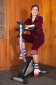 Woman exercise on spinning bike — Stock Photo
