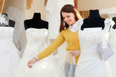 Woman shopping for wedding outfit in bridal boutique — Stock Photo