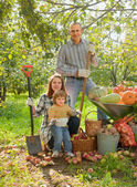 Happy family with vegetables harvest — Stock Photo