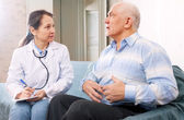 Mature man tells the doctor the symptoms — Stock Photo