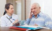 Doctor examining the senior patient — Stock Photo