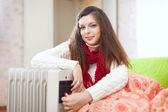 Woman near oil heater — Stock Photo