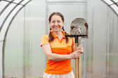 Gardener with spade and rake — Stock Photo