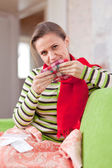 Sick woman uses handkerchief — Foto Stock