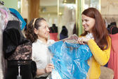 Buyers chooses evening dress in the store — Stock Photo