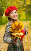 Happy senior woman in autumn — Stock Photo