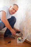 Man repairs the socket — Стоковое фото