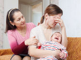 Mature woman gives solace to crying adult daughter — Stock Photo