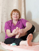 Woman caring for the nails on feet — Stock Photo