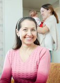 Mature woman against young mother with baby — Stock Photo