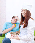 Doctor gives to patient the medication — Stock Photo