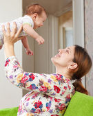 Happy mother holds to her baby — Stock Photo