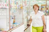 Mature woman buys drugs — Stock Photo