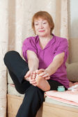 Woman caring for the nails on your feet — Stock Photo