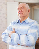 Wistful grizzled elderly man — Stock Photo