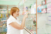 Woman near counter in drugstore — Stock Photo