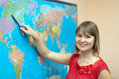 Woman shows something on worldmap — Stock Photo