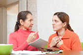 Mother scolds daughter for payments bills or credits — Stock Photo