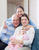 Happy grandparents with daughter and granddaughter — Stock Photo