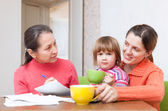 Family of three generation calculates the budget — Stock Photo