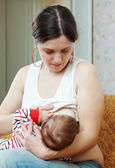 Mother breast feeding her baby — Stock Photo