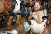 Mature woman chooses leather bag — Foto de Stock
