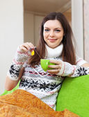 Girl relaxing with cup of tea — Stock Photo