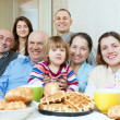 Happy multigeneration family or group of friends — Stock Photo
