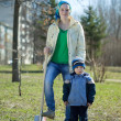 Stock Photo: Womand boy with spade in park