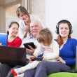 Family with laptops at home — Stock Photo