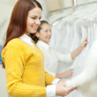 Women choosing bridal dress — Stock Photo