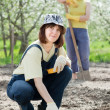 Women works at garden in spring — Foto de stock #25914591
