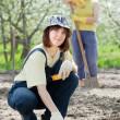 Women works at garden in spring — Stock Photo