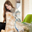 Happy woman with new plaid — Stock Photo #25915007