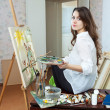 Female artist paints picture on canvas — Stock Photo #25915023