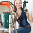 Portrait of woman in overalls with drill — Stock Photo