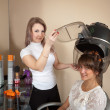Hairdresser working with hair dryer — Stock Photo