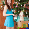 Stockfoto: Girl near decoration spruce