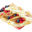 Pancakes with berries over white — Stock Photo #25915799