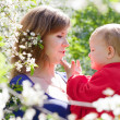 Mother with child  in spring — Stock Photo
