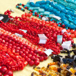 Bracelets and necklaces made of natural gems — Stock Photo